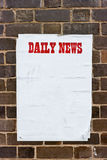 Dirty wrinkled paper on a wall with red text. Royalty Free Stock Photos