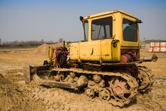 Dirty yellow bulldozer Stock Photography