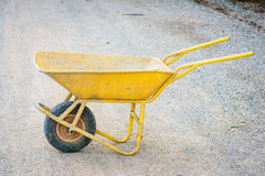 Dirty yellow cart for construction Royalty Free Stock Photos