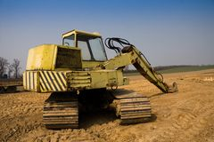Dirty yellow excavator Royalty Free Stock Photography
