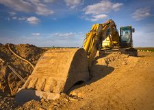 Dirty yellow excavator Stock Images