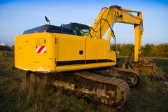 Dirty yellow excavator Royalty Free Stock Image