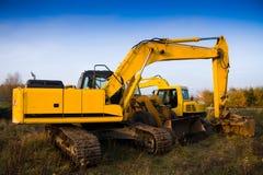 Dirty yellow excavator Stock Image