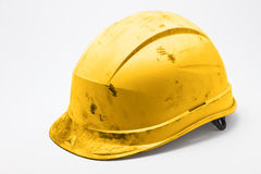 Dirty yellow hard hat Stock Photography