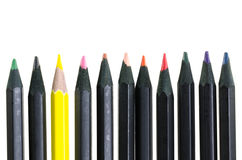 Dirty yellow pencil and black pencils on white background Stock Photography