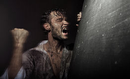 Dirtyand handsome man in despair Stock Images
