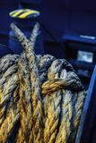 Dirtymooring line on winch. Background.  Copy space. Blur. Blue and yellow stock photos