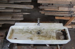 Dirtysink2. Old sink and tap in salvage yard Stock Photos