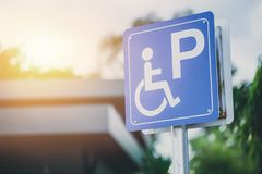Disability car parking sign to reserved space for handicap driver. Vehicle park Stock Photography