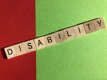 Creative Concept : the word Disability in wooden letters stock image