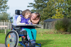 Disabled girl in a wheelchair relaxing Stock Photography