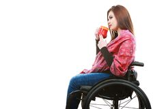 Cheerful crippled lady on wheelchair. Disability drink relax leisure concept. Cheerful crippled lady on wheelchair. Smiling disabled girl holding red cup Royalty Free Stock Images
