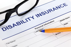 Disability insurance. Form with glasses and ballpoint pen Royalty Free Stock Images