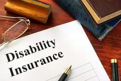 Disability insurance on an office table. Stock Photos
