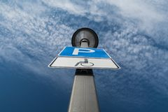 Disability parking spot, clouds and blue sky in the background stock photos