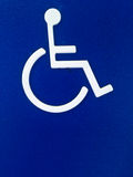 Disability person symbol on blue metal sheet Stock Photography
