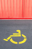 Disability priority sign for wheelchair using on concrete steet Stock Images