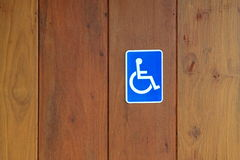 Disability sign. On wooden background Royalty Free Stock Photos