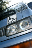 Disability sign on the car Royalty Free Stock Image