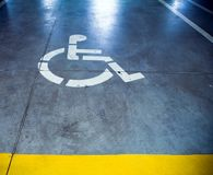Disability sign in parking garage, underground Stock Photo