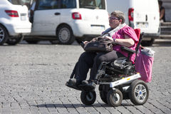 Disability woman with little car (wheelchair) Stock Photos