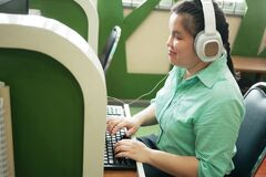 Free Disability Young Blind Person Happy Woman In Headphone Typing On Computer Keyboard Working In Creative Workplace Office Royalty Free Stock Images - 193669219