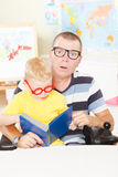 Disable father reading with little son. Disable father and his little son reading a book together stock photos