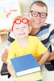 Disable father reading with little son. Stock Photos