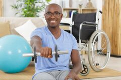 Disable man holding dumbbells in hands