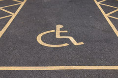 Disable Parking Lot. Yellow Line on Black Road royalty free stock photos