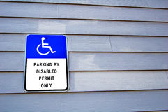Disabled. Parking sign on wooden wall Royalty Free Stock Photo