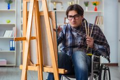 The disabled artist painting picture in studio. Disabled artist painting picture in studio Royalty Free Stock Photography