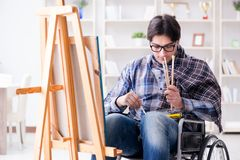 The disabled artist painting picture in studio Stock Photos