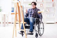 The disabled artist painting picture in studio Stock Photography