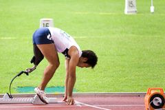 Disabled Athlete. Image of a disabled athlete from Japan competing in men's 200 meters sprint event at the 9th Fespic Games held in Kuala Lumpur, Malaysia, from stock images