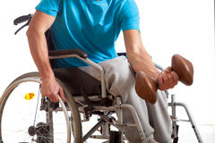 Disabled athlete at gym. Disabled young athlete exercising at gym, horizontal Royalty Free Stock Image