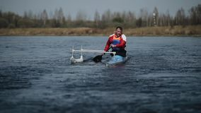Disabled athlete rowing on the river in a canoe. Rowing, canoeing, paddling. Training. Kayaking. paraolympic sport. Disabled Athlete rowing on the river in a stock video