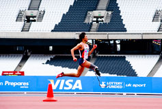 Disabled athlete running at London 2012 stadium. Athlete at the Visa London Disability Athletics Challenge at the Olympic Stadium in London on May 8, 2012. The Royalty Free Stock Images