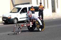 Disabled athlete in a sport wheelchair in marathon Royalty Free Stock Photos