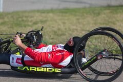 Disabled Athlete training with His Hand Bike on a Track