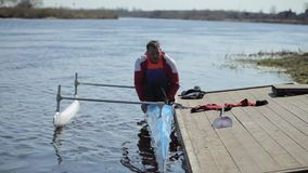 Disabled athlete trying to get off the boat at the pier. Rowing, canoeing, paddling. Training. Kayaking. Water sport stock video