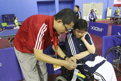 Disabled athletes. The coach was giving advice to athletes with disabilities before competing in Karanganyar Central Java, Indonesia Stock Photos