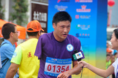 Disabled athletes was being interviewed. Half international marathon in fushui county in yunnan province in China, time: on September 25, 2013 Stock Photos