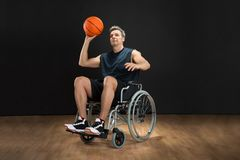 Disabled basketball player throwing ball Royalty Free Stock Image