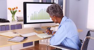 Disabled black businesswoman working at desk Royalty Free Stock Image