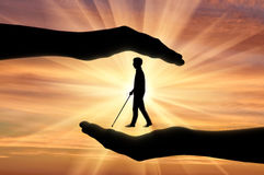 Disabled blind with cane in hands sunset Stock Images