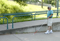 Disabled blind man with walking cane Royalty Free Stock Photo