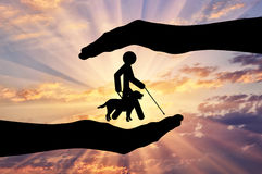 Disabled blind with stick hold guide-dog into hands sunset icon Stock Photography