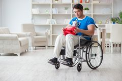 The disabled boxer at wheelchair recovering from injury Royalty Free Stock Images