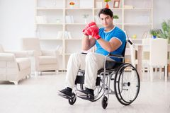 The disabled boxer at wheelchair recovering from injury. Disabled boxer at wheelchair recovering from injury Stock Images